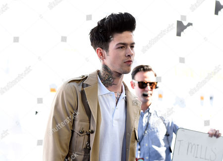 T. Mills arrives at the MTV Movie Awards at the Nokia Theatre, in Los Angeles