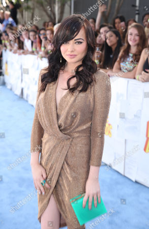 Ashley Rickards arrives at the MTV Movie Awards at the Nokia Theatre, in Los Angeles