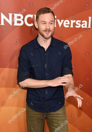 Aaron Ashmore arrives at the NBC Universal Summer Press Day at The Langham Huntington Hotel, in Pasadena, Calif
