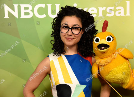 Carly Ciarrocchi, left, and Chica arrive at the NBC Universal Summer Press Day at The Langham Huntington Hotel, in Pasadena, Calif