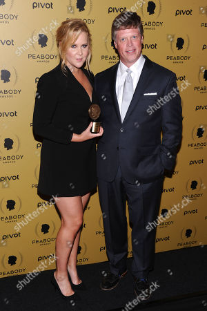 Amy Schumer, left, and Jeffrey P. Jones attends the 74th Annual Peabody Awards at Cipriani Wall Street, in New York