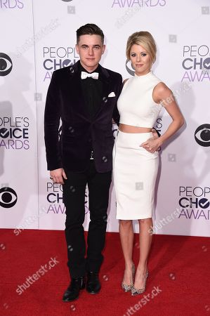 Jesse McCartney, left, and Katie Peterson arrive at the People's Choice Awards at the Nokia Theatre, in Los Angeles