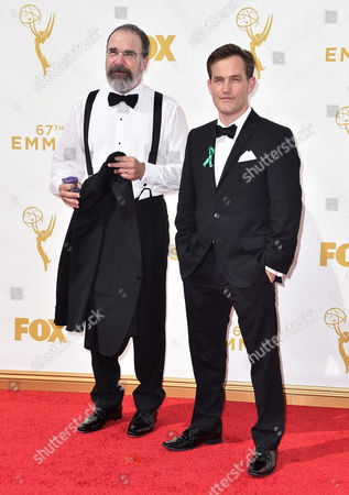 Mandy Patinkin, left, and Maury Sterling arrive at the 67th Primetime Emmy Awards, at the Microsoft Theater in Los Angeles