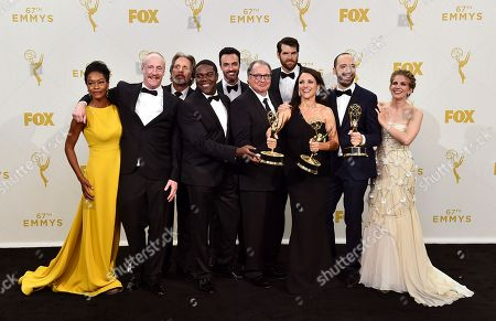 """The cast of """"Veep"""", from left, Sufe Bradshaw, Matt Walsh, Gary Cole, Sam Richardson, Reid Scott, Kevin Dunn, Timothy C. Simons, Julia Louis'Dreyfus, Tony Hale and Anna Chlumsky, winners of the award for outstanding comedy series, pose in the press room at the 67th Primetime Emmy Awards, at the Microsoft Theater in Los Angeles"""