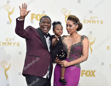 Tracy Morgan, from left, Maven Sonae Morgan, and Megan Wollover pose in the press room at the 67th Primetime Emmy Awards, at the Microsoft Theater in Los Angeles