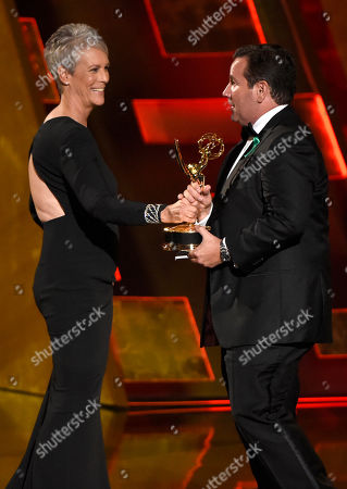 Jamie Lee Curtis, left, presents the award for outstanding directing in a drama series to David Nutter for â?oeGame Of Thronesâ?? at the 67th Primetime Emmy Awards, at the Microsoft Theater in Los Angeles
