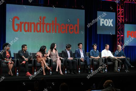 Actors Kelly Jenrette, from left, Ravi Patel, Christina Milian, Paget Brewster, Josh Peck, John Stamos, Creator/writer/executive producer Daniel Chun, executive producers Dan Fogelman and Chris Koch participate in 'Grandfathered' panel at the Fox Television Critics Association Summer Tour at the Beverly Hilton Hotel, in Beverly Hills, Calif
