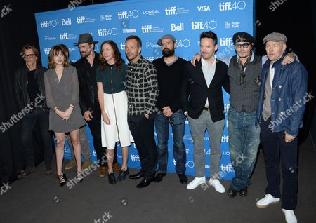 """Kevin Bacon, from left, Dakota Johnson, David Harbour, Julianne Nicholson, Peter Sarsgaard, Rory Cochrane, director Scott Cooper, Johnny Depp and Joel Edgerton attend a press conference for """"Black Mass"""" on day 5 of the Toronto International Film Festival at the TIFF Bell Lightbox, in Toronto"""