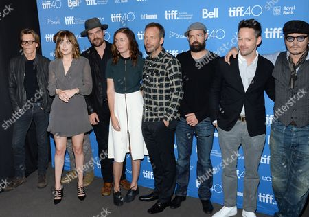 """The cast, from left, Kevin Bacon, Dakota Johnson, David Harbour, Julianne Nicholson, Peter Sarsgaard, Rory Cochrane, director Scott Cooper and Johnny Depp attend the photo call for """"Black Mass"""" on day 5 of the Toronto International Film Festival at the TIFF Bell Lightbox, in Toronto"""