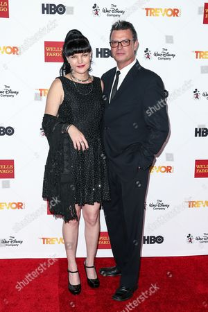 Pauley Perrette, left, and Thomas Arklie attend 2015 TrevorLIVE LA held at the Hollywood Palladium, in Los Angeles