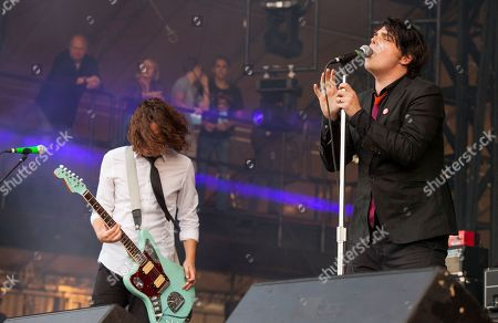 On right, Gerard Way performs with his band at the Voodoo Music Experience, in New Orleans