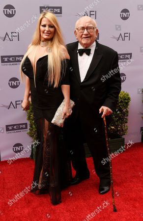 Stock Image of Actor Ed Asner poses with actress Yvette Rachelle at the 2016 AFI Life Achievement Award Gala Tribute to John Williams at the Dolby Theatre, in Los Angeles