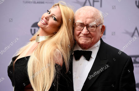 Stock Photo of Actor Ed Asner poses with actress Yvette Rachelle at the 2016 AFI Life Achievement Award Gala Tribute to John Williams at the Dolby Theatre, in Los Angeles