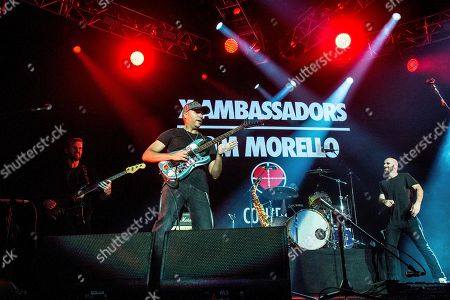Tom Morello, center, performs with Noah Feldshuh, Adam Levin, and Sam Harris of X Ambassadors at the 2016 KROQ Almost Acoustic Christmas at The Forum, in Inglewood, Calif