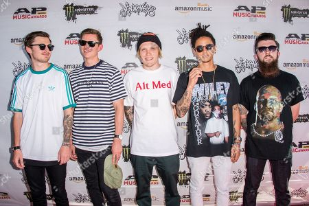Sam Bowden, from left, Fil Thorpe Evans, Ben Barlow, Dani Washington, and Matt West of Neck Deep arrive at the 2016 Journeys AP Music Awards at Value City Arena at the Jerome Schottenstein Center, in Columbus, Ohio