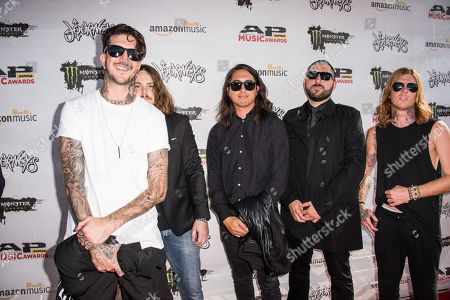 Stock Image of Austin Carlile, from left, Aaron Pauley, Phil Manansala, Valentino Arteaga, and Alan Ashby of Of Mice & Men arrive at the 2016 Journeys AP Music Awards at Value City Arena at the Jerome Schottenstein Center, in Columbus, Ohio