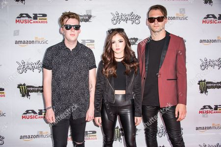Will Ferri, from left, Chrissy Costanza, and Dan Gow of Against The Current arrive at the 2016 Journeys AP Music Awards at Value City Arena at the Jerome Schottenstein Center, in Columbus, Ohio