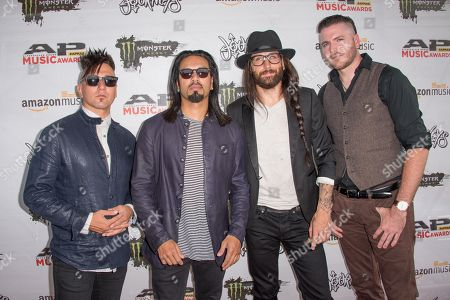 Dave Grahs, fom left, Leigh Kakty, Matt DiRito, Nick Fuelling, and Eric Poncet of Pop Evil arrive at the 2016 Journeys AP Music Awards at Value City Arena at the Jerome Schottenstein Center, in Columbus, Ohio