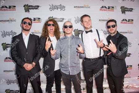 B.J. Stead, from left, Levi Benton, Ryan Neff, Justin Aufdemkampe, and Jerod Boyd of Miss May I arrive at the 2016 Journeys AP Music Awards at Value City Arena at the Jerome Schottenstein Center, in Columbus, Ohio