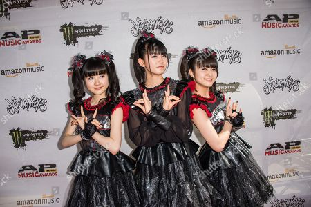 Yui Mizuno, from left, Suzuka Nakamoto, and Moa Kikuchi of BABYMETAL arrive at the 2016 Journeys AP Music Awards at Value City Arena at the Jerome Schottenstein Center, in Columbus, Ohio
