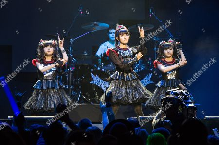Stock Photo of Yui Mizuno, from left, Suzuka Nakamoto, and Moa Kikuchi of BABYMETAL perform at the 2016 Journeys AP Music Awards at Value City Arena at the Jerome Schottenstein Center, in Columbus, Ohio