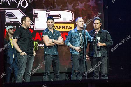 Ryan Key, Sean Mackin, Ryan Mendez, and Josh Portman of Yellowcard speak at the 2016 Journeys AP Music Awards at Value City Arena at the Jerome Schottenstein Center, in Columbus, Ohio