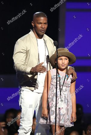 Jamie Foxx, left, and Annalise Bishop speak at the BET Awards at the Microsoft Theater, in Los Angeles