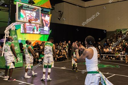 Stock Picture of Marcellus Wiley, from left, Young Greatness, and Flex Alexander play at the BET Experience - Sprite celebrity basketball game held at the Los Angeles Convention Center on