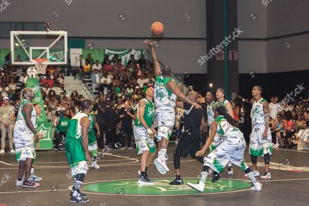 The Game, center, and Doug Christie jump at the BET Experience - Sprite celebrity basketball game held at the Los Angeles Convention Center on