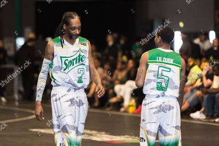 Snoop Dogg, left, and Lil Durk play at the BET Experience - Sprite celebrity basketball game held at the Los Angeles Convention Center on