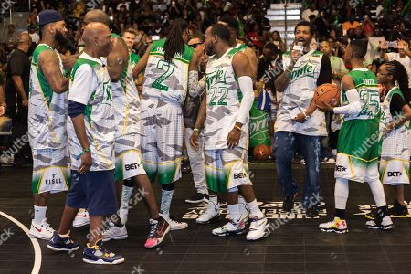 The Game, from left, Big Boy, Snoop Dogg, Young Greatness, Dean Cole, Silento, and Marsai Martin play at the BET Experience - Sprite celebrity basketball game held at the Los Angeles Convention Center on