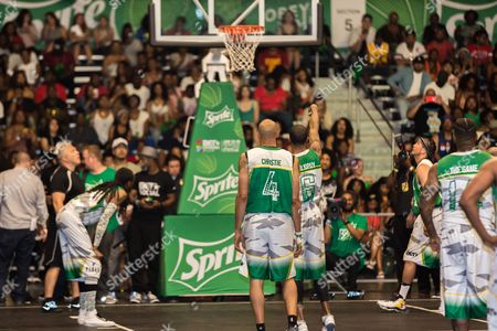 Snoop Dogg, from left, Doug Christie, Guy Dupuy, Kenny Dobbs, and The Game play at the BET Experience - Sprite celebrity basketball game held at the Los Angeles Convention Center on