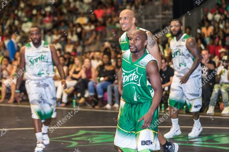 Stock Picture of Floyd Mayweather and Doug Christie play at the BET Experience - Sprite celebrity basketball game held at the Los Angeles Convention Center on