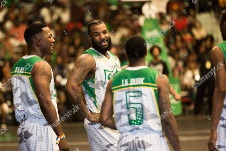 Flex Alexander, from left, The Game, and Lil Durk play at the BET Experience - Sprite celebrity basketball game held at the Los Angeles Convention Center on