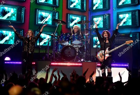 Belinda Carlisle, from left, Gina Schock and Abby Travis, of the The Go Go's, perform We Got The Beat at the Billboard Music Awards at the T-Mobile Arena, in Las Vegas