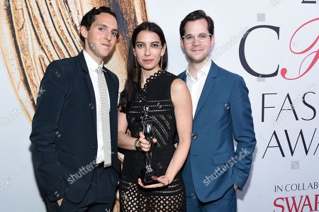 Stock Photo of Swarovski Menswear Award winners, Alex Orley, from left, Samantha Florence, and Matthew Orley, of Orley, pose at the CFDA Fashion Awards at the Hammerstein Ballroom, in New York