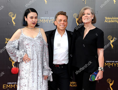 Stock Photo of Jennifer Salim, from left, Paolo Nieddu, and Mary Lane arrive at night one of the Creative Arts Emmy Awards at the Microsoft Theater, in Los Angeles