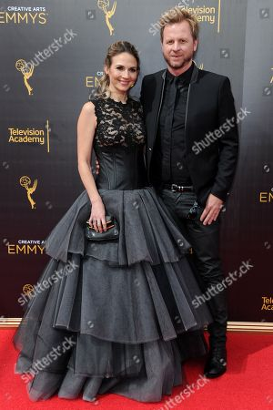 Stock Photo of Gary Kordan, right, and Justine Ungaro arrive at night two of the Creative Arts Emmy Awards at the Microsoft Theater, in Los Angeles