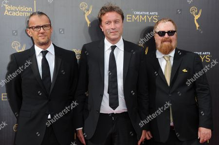 John Battsek, from left, Andrew Ruhemann, and R.J. Cutlet arrive at night two of the Creative Arts Emmy Awards at the Microsoft Theater, in Los Angeles