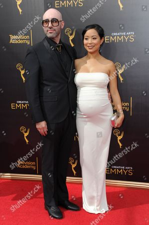 Michelle Ang, right, and guest arrive at night two of the Creative Arts Emmy Awards at the Microsoft Theater, in Los Angeles