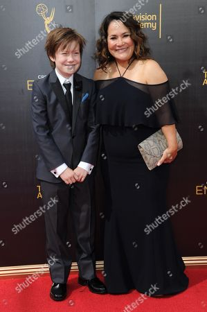 Stock Image of Carolyn Omine, right, and gust arrive at night two of the Creative Arts Emmy Awards at the Microsoft Theater, in Los Angeles