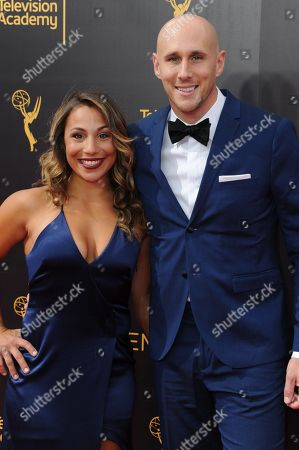 Stock Photo of Josh Wingate, right, and guest arrives at night two of the Creative Arts Emmy Awards at the Microsoft Theater, in Los Angeles