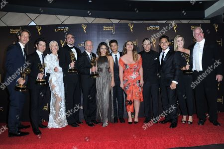 "David Korins, from left, Thomas Kail, Julianne Hough, Adam Siegel, Marc Platt, Vanessa Hudgens, Jordan Fisher, Kether Donohue, David Del Rio, Carlos PenaVega, and Gregory Sills pose in the press room with their awards for outstanding special class program for ""Grease: Live"" during night two of the Creative Arts Emmy Awards at the Microsoft Theater, in Los Angeles"