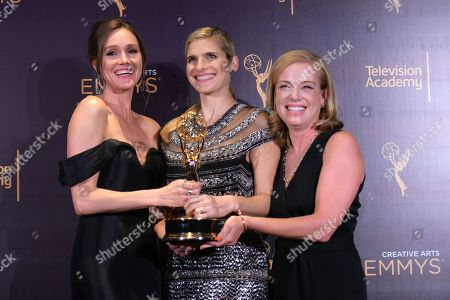 """Erinn Hayes, from left, Lake Bell, and Zandy Hartig pose in the press room with the award for outstanding short form comedy or drama series for """"Children's Hospital"""" during night two of the Creative Arts Emmy Awards at the Microsoft Theater, in Los Angeles"""