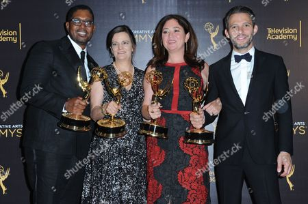 Stock Photo of Jayson Jackson, from left, Amy Hobby, Liz Garbus, and Justin Wilkes from What Happened, Miss Simone? pose in the press room with their award for outstanding documentary or nonfiction special during night two of the Creative Arts Emmy Awards at the Microsoft Theater, in Los Angeles