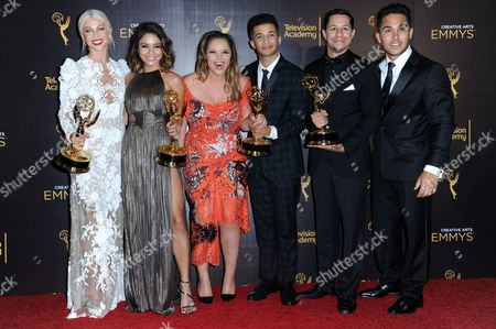 "Julianne Hough, from left, Vanessa Hudgens, Kether Donohue, Jordan Fisher, David Del Rio, and Carlos PenaVega pose in the press room with their awards for outstanding special class program for ""Grease: Live"" during night two of the Creative Arts Emmy Awards at the Microsoft Theater, in Los Angeles"