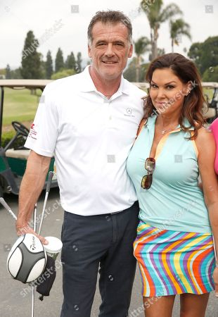 Bruce Thomas, left, and Paula Trickey attend the 2016 Emmys Golf Classic presented by the Television Academy Foundation at the Wilshire Country Club, in Los Angeles