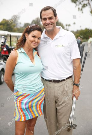 Paula Trickey, left, and Andy Buckley attend the 2016 Emmys Golf Classic presented by the Television Academy Foundation at the Wilshire Country Club, in Los Angeles
