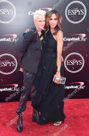 Stock Picture of Professional surfer, Keala Kennelly, and Nikki DiSanto arrive at the ESPY Awards at the Microsoft Theater, in Los Angeles