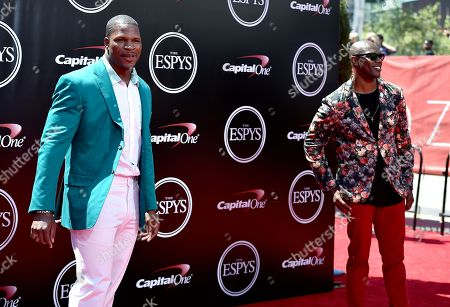 Former NFL players Kamerion Wimbley, left, and Terrell Owens arrive at the ESPY Awards at the Microsoft Theater, in Los Angeles